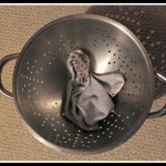 Two socks…and a colander