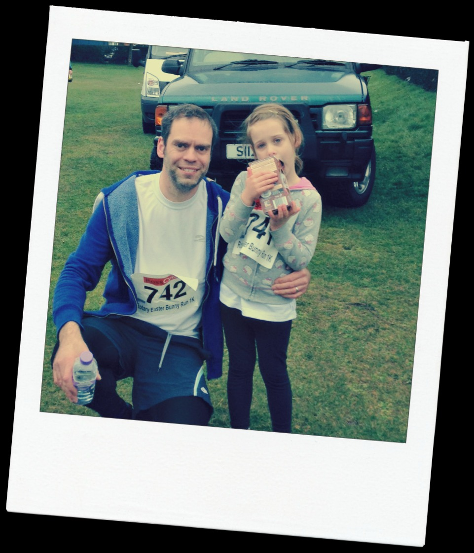 Dad and daughter completing a fun run
