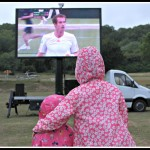 Wimbledon, on the big screen, in the rain.
