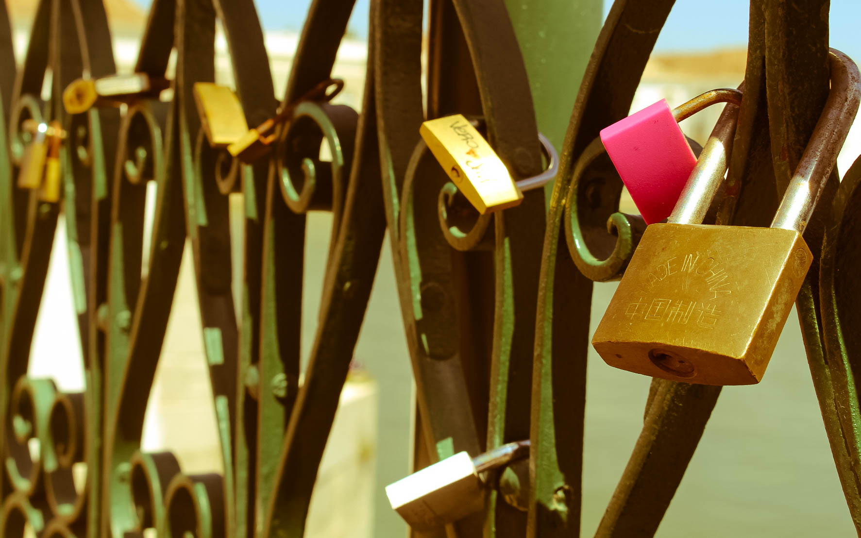 Love locks fixed to the Ponte Romana