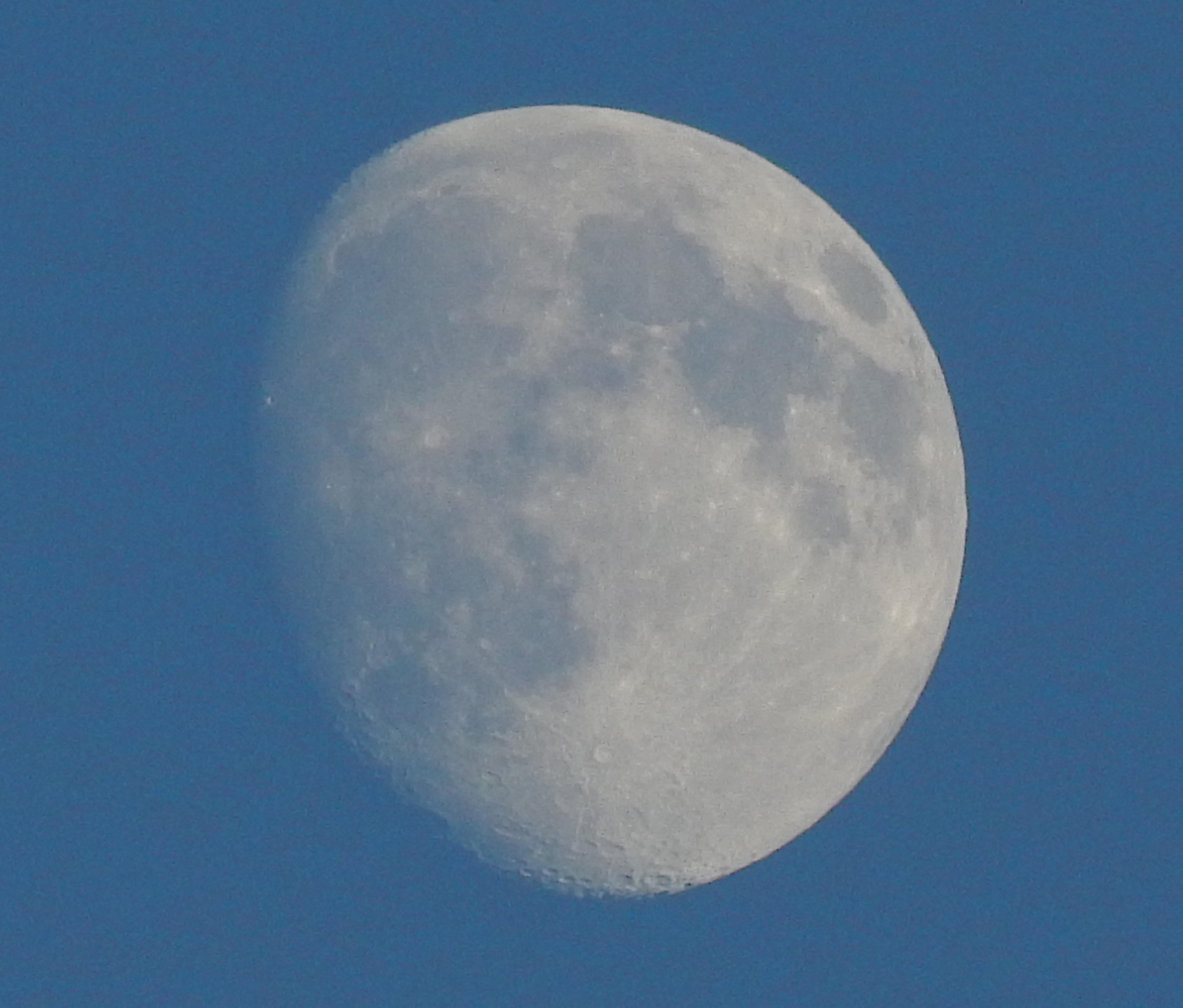 A waxing moon in the early evening
