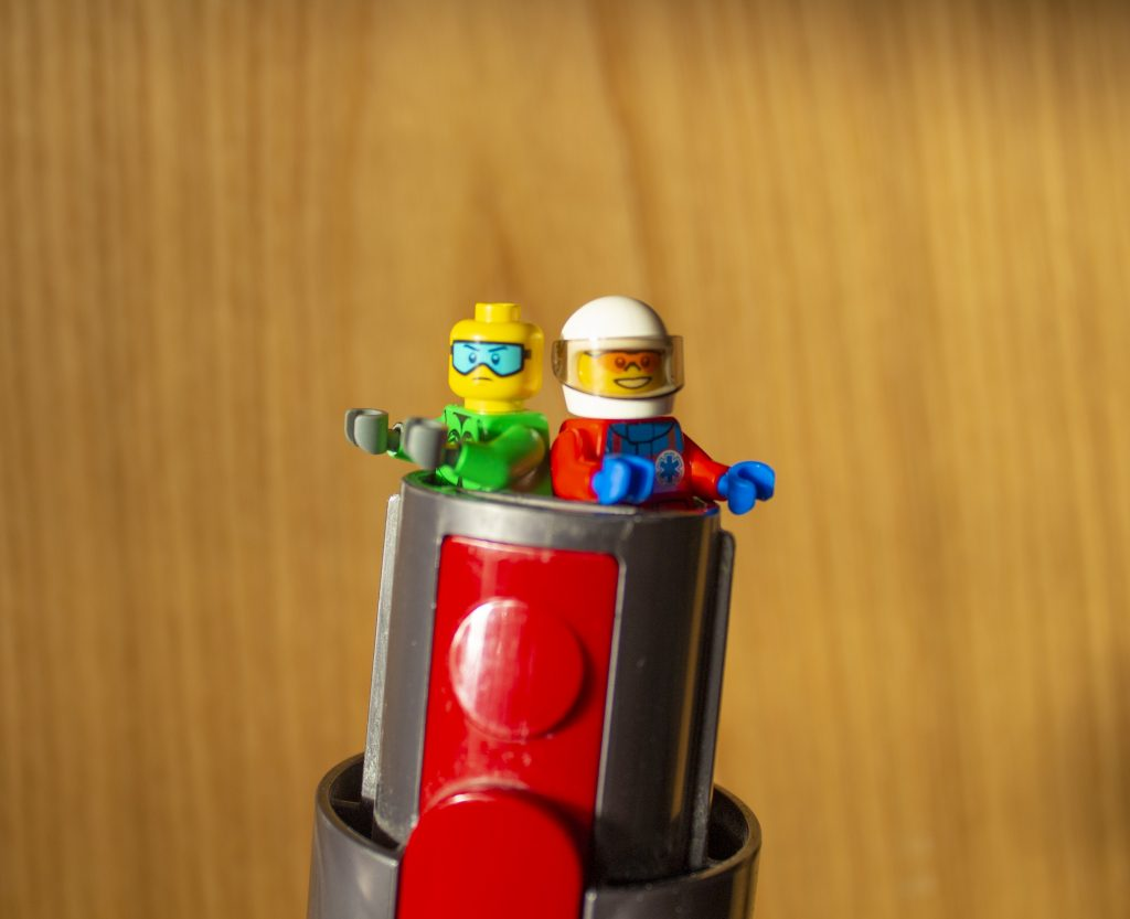 LEGO characters trying to escape a vacuum cleaner.