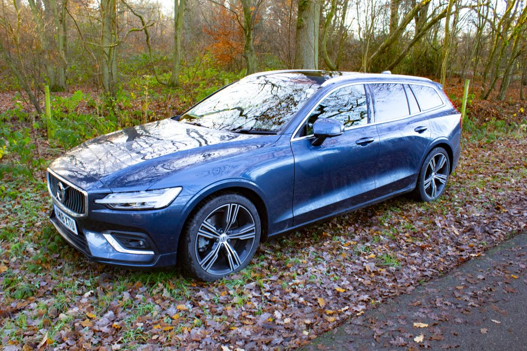 Volvo V60 D4 parks on the verge of a country lane.