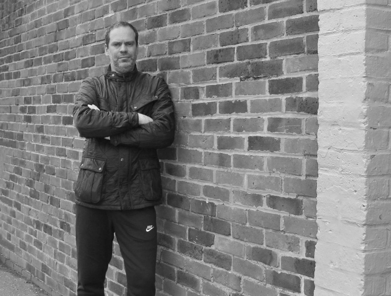 John Adams of Dadbloguk wearing Barbour International Ariel jacket and Nike Club jogging bottoms.