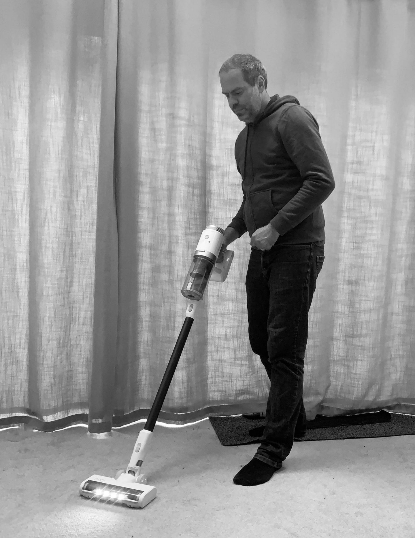 JOhn Adams of Dadbloguk using Eufy HomeVac S11 vacuum cleaner