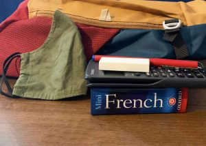 back to school. School bag with face mask, books etc.