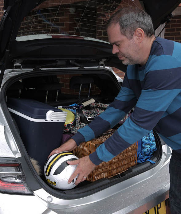 Loading up the boot of the Toyota Corolla.