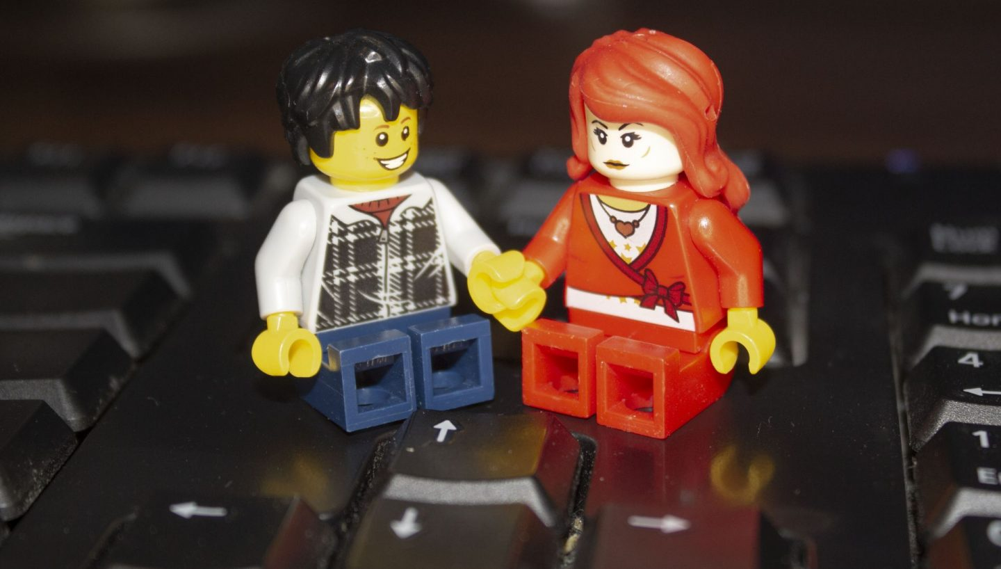 Lego couple sharing a home office.