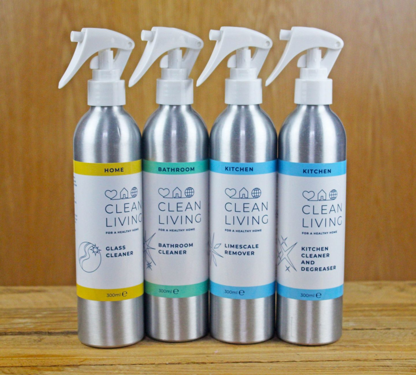 Reusable aluminum bottles for household cleaning products from Clean Living.
