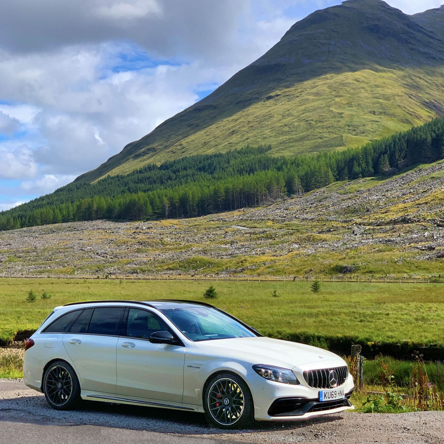 A Mercedes-AMG C 63 parked at the side of the road in Scotland.