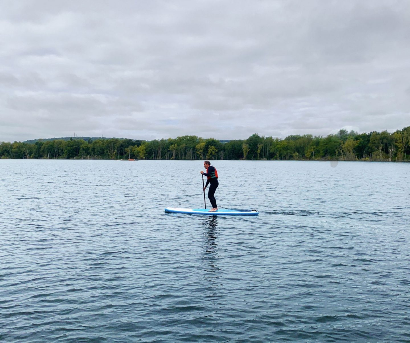 John Adams of Dadbloguk using a SUP  or stand up paddleboard