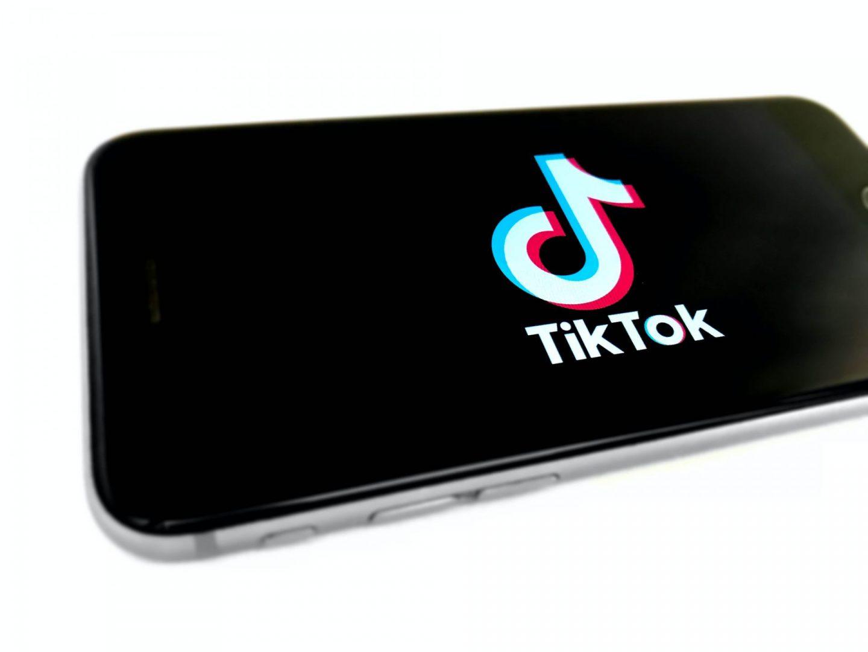 TikTok family pairing: TikTok logo on a  phone.