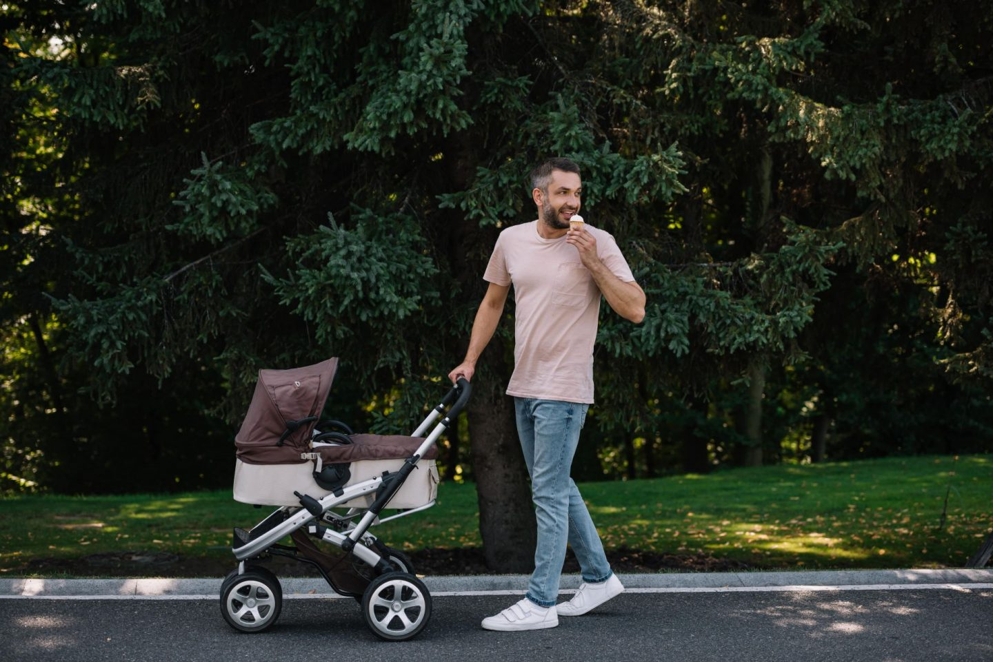 Father pushing a pram. Earn money with Y'earn or earn money renting out baby and child products.