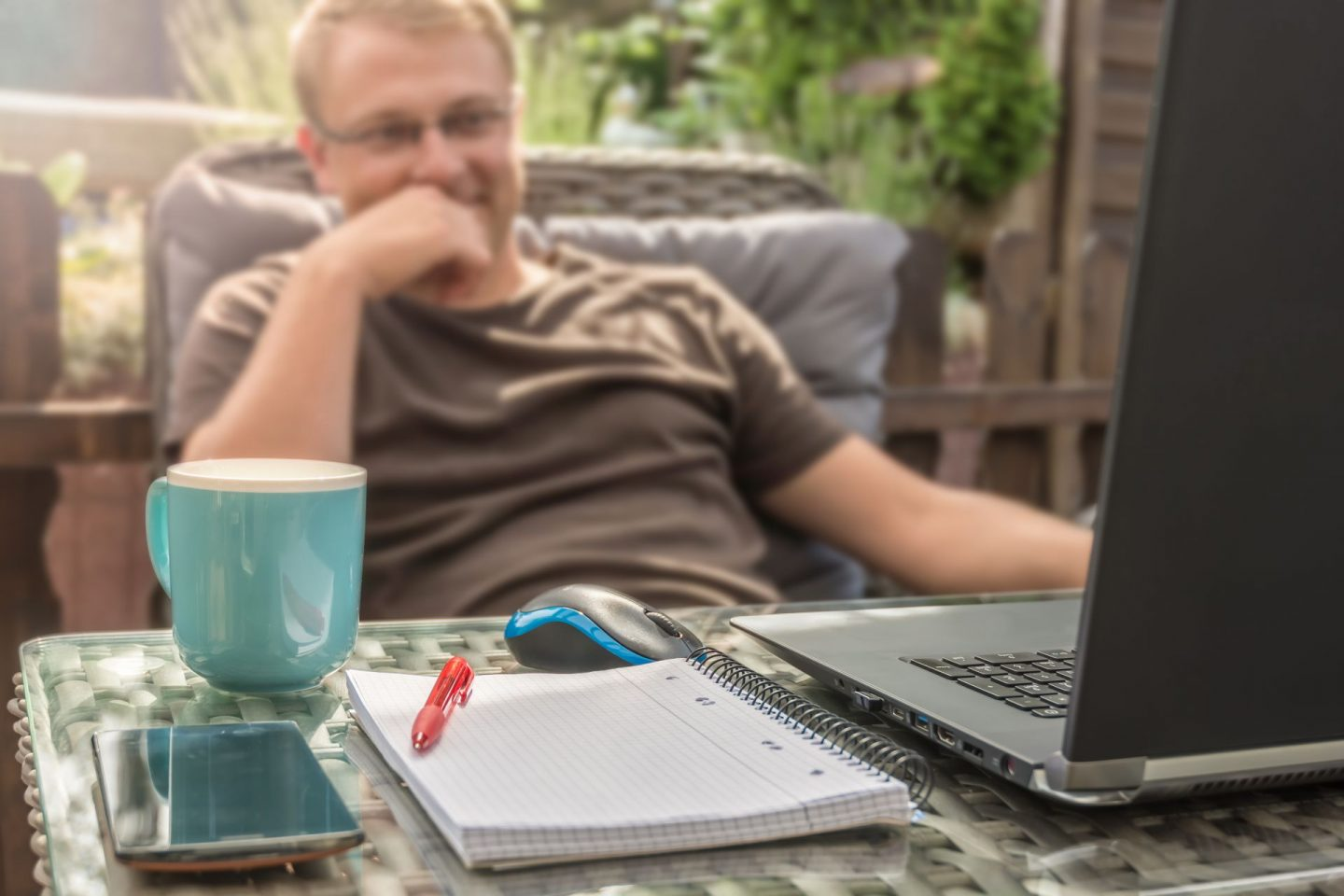 Flexible working during COVID-19. Image of a man working from home.