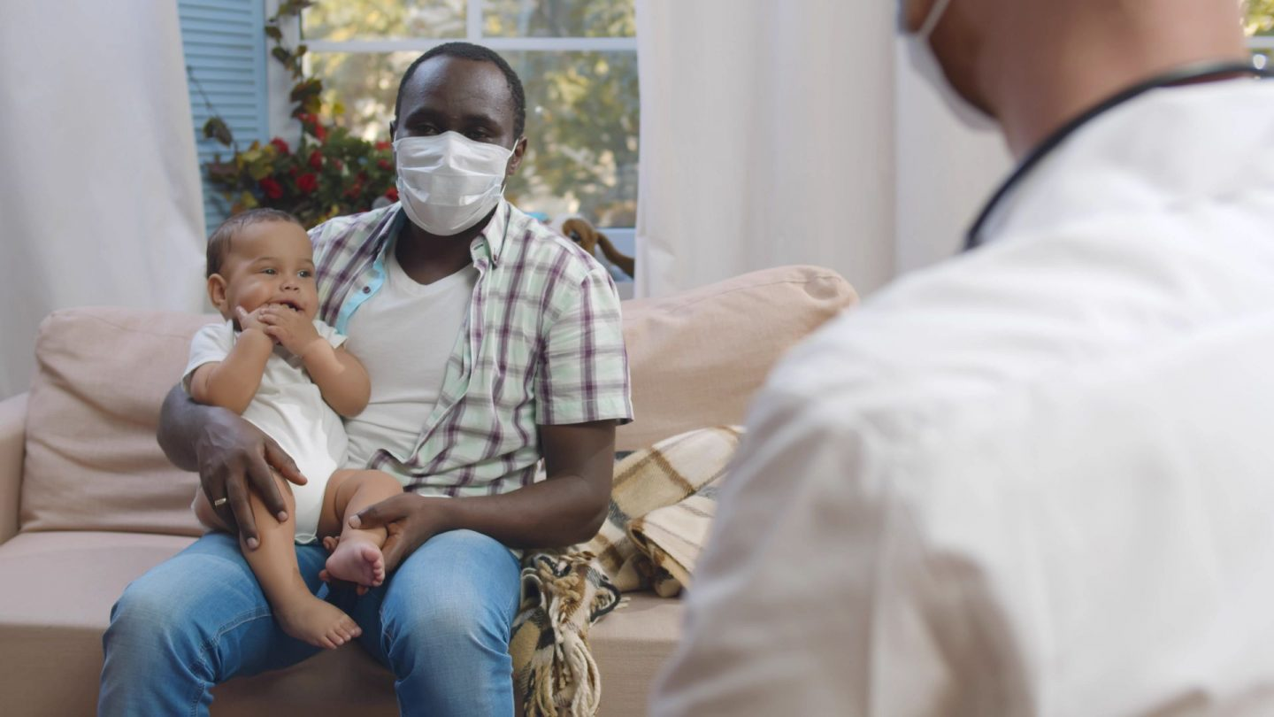 Dads in the pandemic. A father and his newborn son.