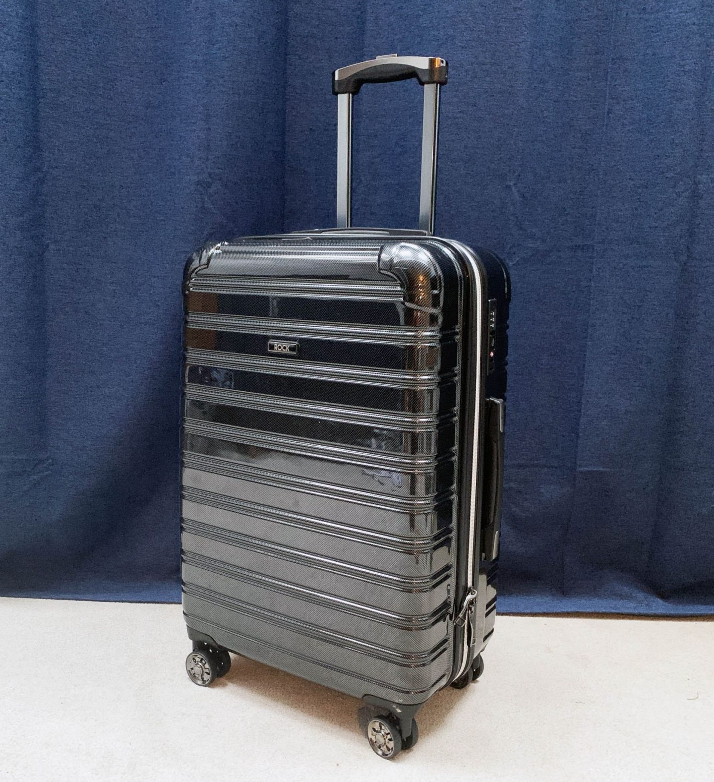 Hard shell suitcase.
