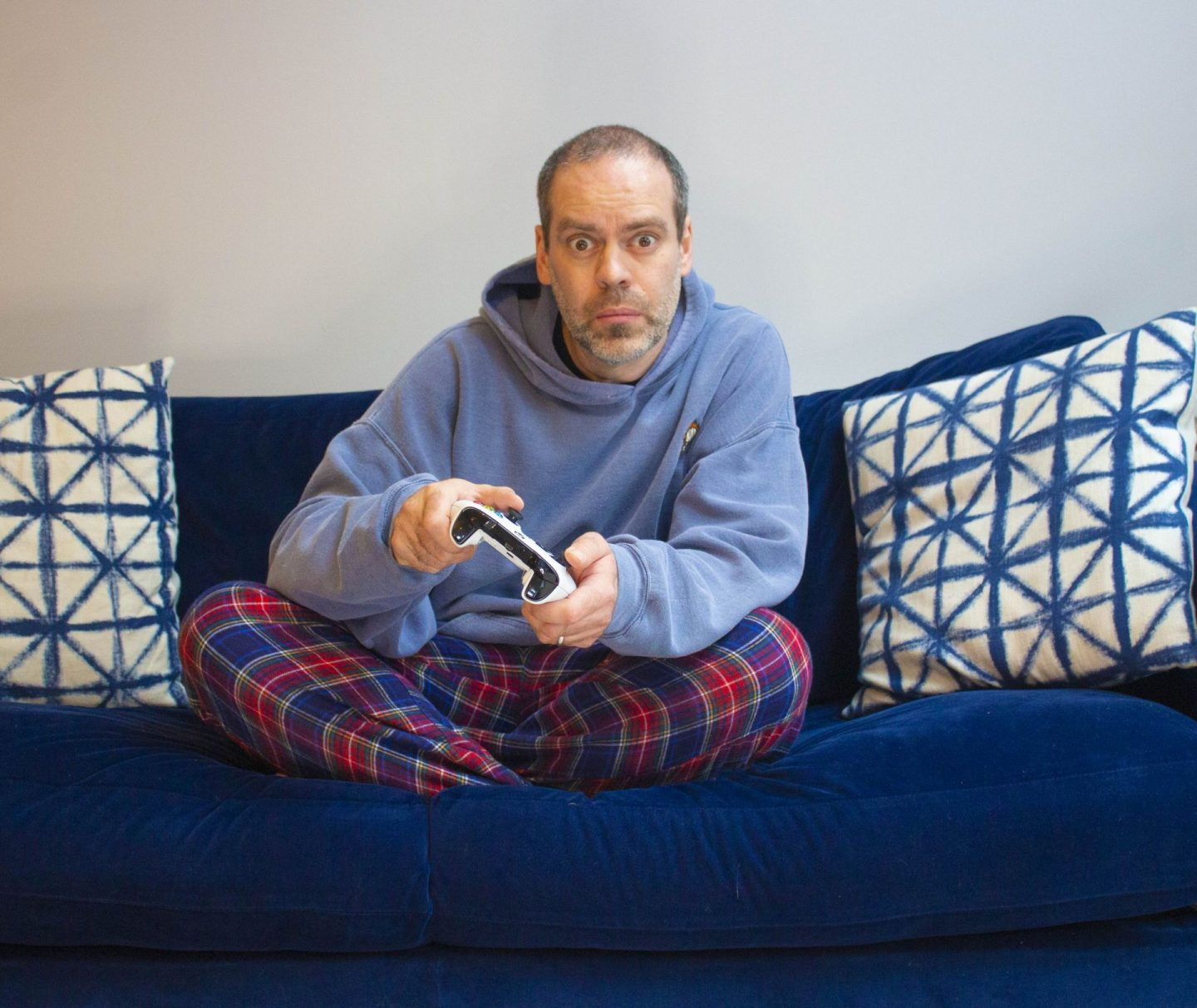 Man with no motivation sat on a sofa