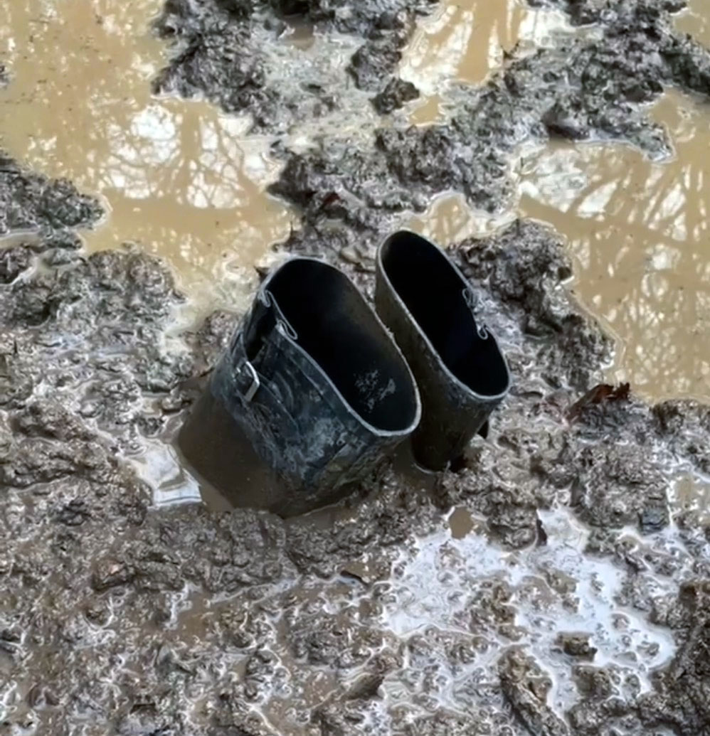 Wellington boots that are stuck in the mud