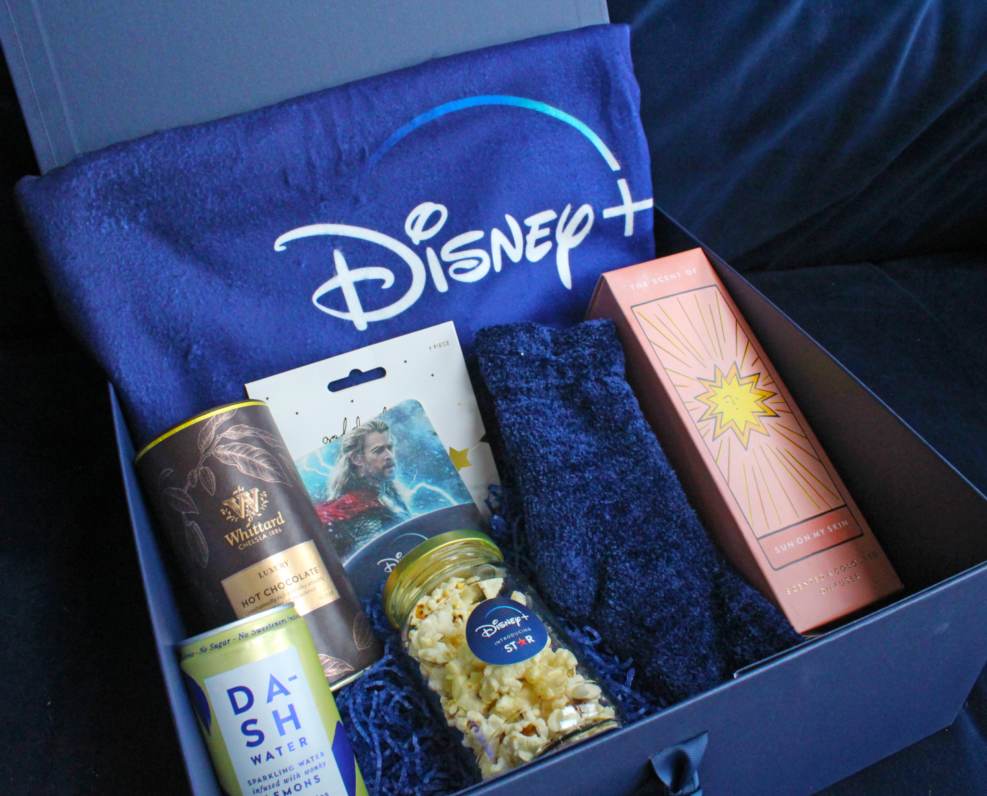 Disney+ gift box celebrating Star coming to the platform