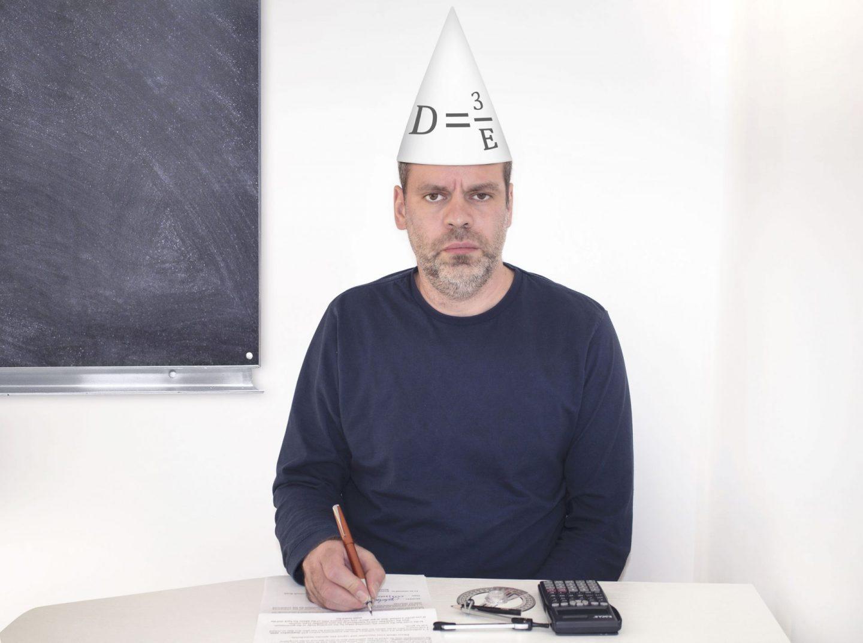 GCSE maths, man in dunces hat