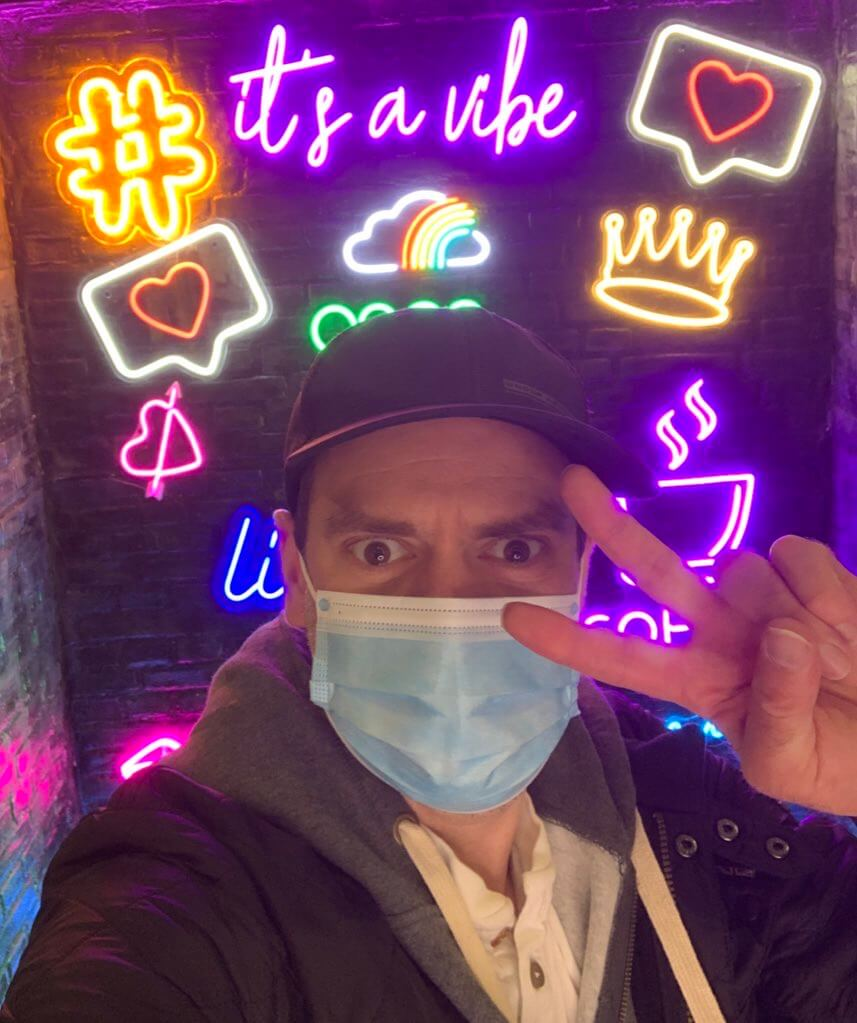 Man in selfie booth celebrating COVID vaccine