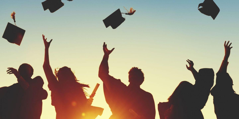 University graduates celebrating graduation.