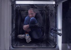 Man in dishwasher