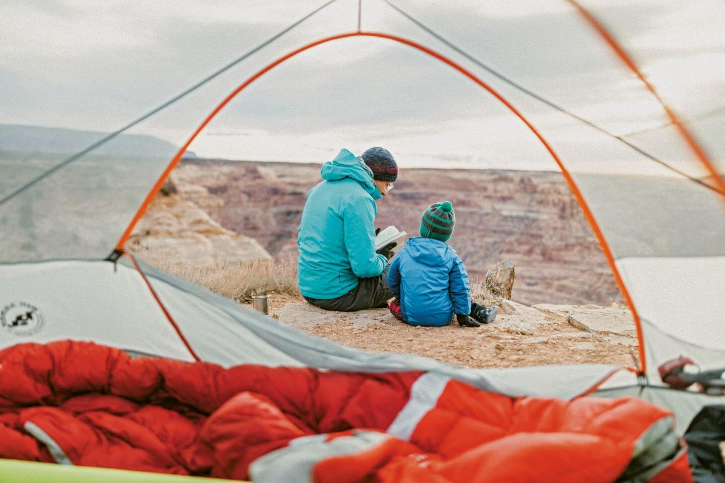 Parent and child camping in The Camping Life book