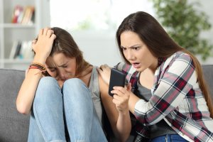 online safety bill, youngsters looking at phone